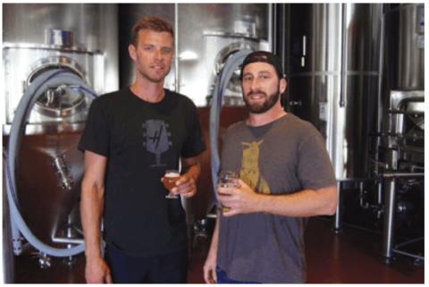 Eric Tisch, left, and Jon Verna inside Harmonic Brewing's production room. PHOTOGRAPH BY MATT KANG